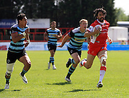 Ade Gardner (right) of Hull Kingston Rovers breaks away from the Broncos defence during the First Utility Super League match at the KC Lightstream Stadium, Kingston upon Hull<br /> Picture by Richard Gould/Focus Images Ltd +44 7855 403186<br /> 25/05/2014
