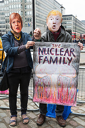 London, UK. 3 May, 2019. Two protesters wearing Theresa May and Donald Trump masks join campaigners from Campaign For Nuclear Disarmament (CND), Stop the War Coalition, the Peace Pledge Union, the Quakers and other faith groups protesting opposite Westminster Abbey against the holding of a National Service of Thanksgiving to mark fifty years of the Continuous at Sea Deterrent (CASD) attended by dignitaries including the Duke of Cambridge and the newly appointed Defence Secretary Penny Mordaunt.