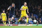 AFC Wimbledon midfielder Mitchell (Mitch) Pinnock (11) and Southend United midfielder Ethan Hamilton (16) battles for possession during the EFL Sky Bet League 1 match between Southend United and AFC Wimbledon at Roots Hall, Southend, England on 12 October 2019.