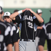 Laura Stoecker/lstoecker@dailyherald.com<br /> An emotional Kaneland's Matt Rosko shield his face as the Knights return to the dugout following their loss to Belvidere North in the Class 3A Sycamore sectional semifinal Wednesday.