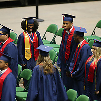 Nettleton seniors make their way to their seats as their graduation gets started Saturday monring at the BancorpSouth Arena.