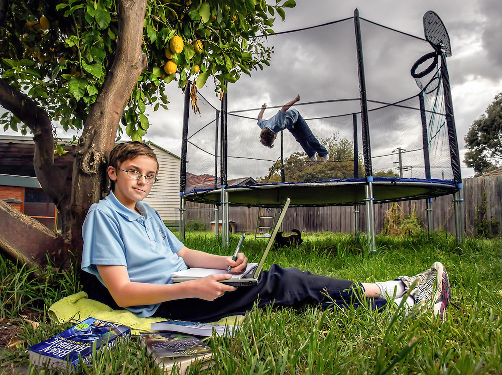Child author Max Sillitoe (11 years) working on his second book  to be self published by www.kidpub.com. Brother Jack (9 years) wants Max to stop writing &amp; hop on the trampoline with him. Pic By Craig Sillitoe Photography, 12/10/2012 This photograph can be used for non commercial uses with attribution. Credit: Craig Sillitoe Photography / http://www.csillitoe.com<br />