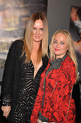 Left to right, Candace McAdams and Erica Bergsmeds at an exhibition of photographs by Erica Bergsmeds held at The Den, 100 Wardour Street, London England. 19 January 2017.