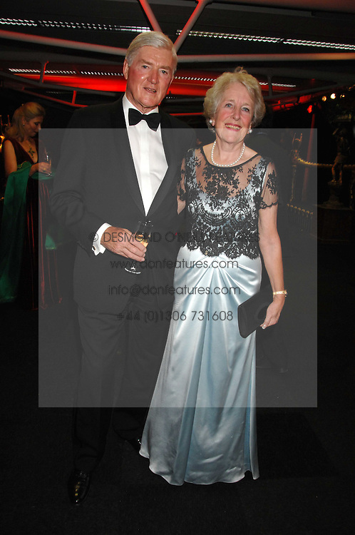 LORD &amp; LADY PARKINSON at the British Red Cross Gala Ball 2007 themed 'East Meets West' held at Old Billingsgate, 16 Lower Thames Street, London on 5th June 2007.<br />