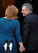 © under license to London News Pictures. 11/05/10. Gordon Brown smiles at his wife Sarah as they enter Number 10 Downing Street after he announces his resignation as British Prime Minister. British Prime Minister Gordon Brown has resigned his position and David Cameron has become the new British Prime Minister on May 11, 2010. The Conservative and Liberal Democrats are to form a coalition government after five days of negotiation. Photo credit should read Stephen Simpson/LNP