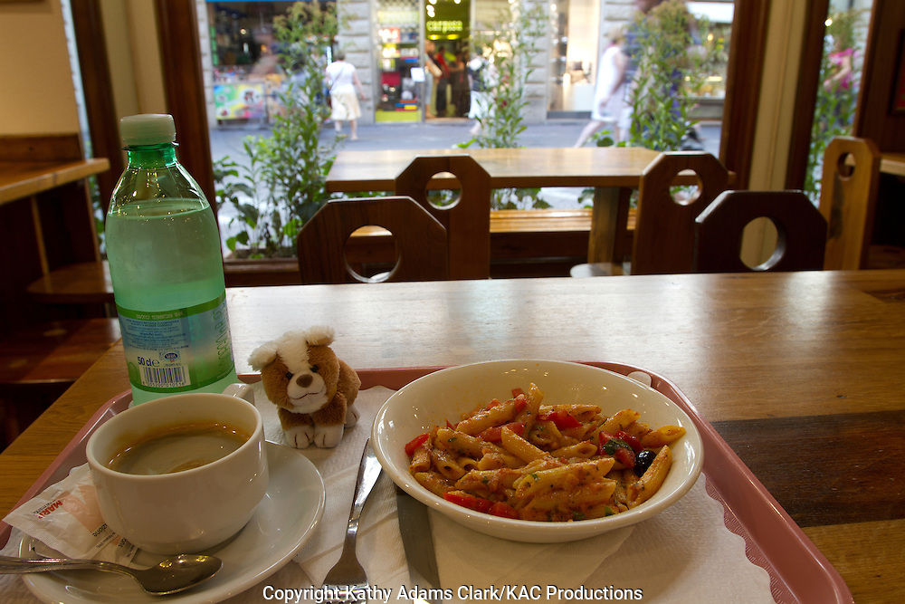 Trudy enjoying pasta, water, and coffee at lunch in Florence, Firenze, Italy.