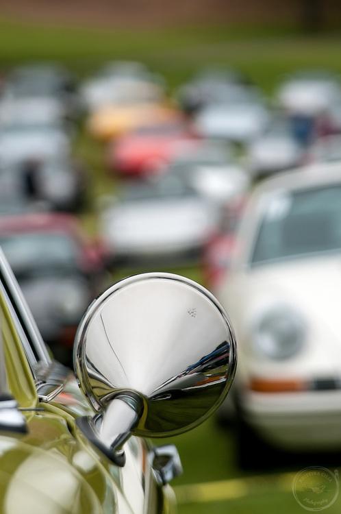 Side view mirror of a Green Porsche 912. Photo by Kristina Cilia
