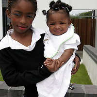 Princess brings her sister Rachel outside to see what all the fuss was about as the Cul na Greine Housing Scheme in Shannon was officially opened on Thursday morning.<br /> <br /> Photograph by Yvonne Vaughan.
