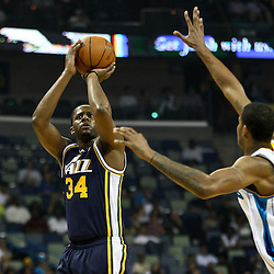 April 11, 2011; New Orleans, LA, USA; Utah Jazz power forward Paul Millsap (24) shoots over New Orleans Hornets small forward Trevor Ariza (1) during the first half at the New Orleans Arena.  Mandatory Credit: Derick E. Hingle