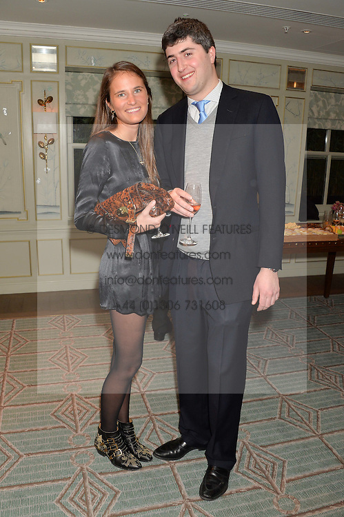 VICTORIA VON WESTENHOLZ and MAX GELBER at the launch of Mrs Alice in Her Palace - a fashion retail website, held at Fortnum & Mason, Piccadilly, London on 27th March 2014.