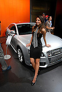 Israel, New model cars on display at a car show, Young female presenter attracting prospective buyers to a Audi S5 April 2008