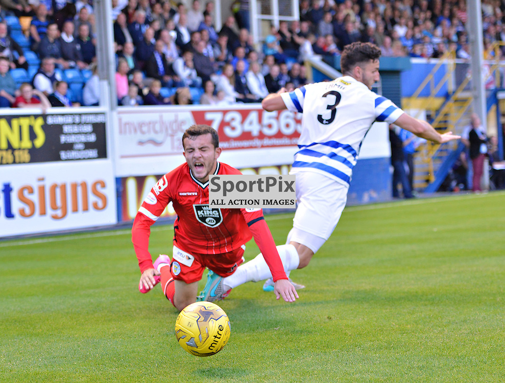 Paul McMullan of Saints goes down in agony after a challenge from Morton's Rickie Lamie<br /> <br /> (c) BILLY WHITE | SportPix.org.uk