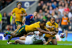 Australia Outside Centre (#13) Tevita Kuridrani (ACT Brumbies) and Scrum-Half (#9) Will Genia (Queensland Reds) touch a loose ball down before England Outside Centre (#13) Joel Tomkins (Saracens) during the second half of the match - Photo mandatory by-line: Rogan Thomson/JMP - Tel: Mobile: 07966 386802 02/11/2013 - SPORT - RUGBY UNION -  Twickenham Stadium, London - England v Australia - Cook Cup - QBE Autumn Internationals.