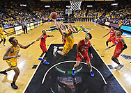Wichita State Shockers guard Erik Stevenson (10) drives to the basket against Southern Methodist Mustangs forward Ethan Chargois (25) during the second half at Charles Koch Arena.