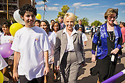 Oct. 4, 2010 - PHOENIX, AZ: Arizona Governor JAN BREWER (center, brown pants suit) walks with BETSEY BAYLESS (right, blue outfit), President of Maricopa Medical Center, and several children during an event to promote children's health care. She was at the hospital to declare Arizona Child Health Day. Gov. Brewer is running for reelection and appears headed to an easy win. Since signing Arizona's tough immigration bill, SB 1070, and cutting budgets for some of Arizona's social services, like health care for children, her popularity has soared. Her reelection campaign has been dogged by protests from education, health care and immigration advocates but she doesn't engage them and continues to be popular in pre-election polling.       Photo by Jack Kurtz