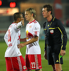 04.12.2011, Stadion, Wiener Neustadt, AUT, 1. FBL, SC Wiener Neustadt vs RB Salzburg, im Bild Leonardo, (Red Bull Salzburg, #30) Stefan Hierlaender, (Red Bull Salzburg, #22) und Schiedsrichter Manfred Krassnitzer during the Austrian Bundesliga Match, SC Wiener Neustadt against RB Salzburg, Stadium, Wiener Neustadt near Vienna, Austria on 2011-12-04, EXPA Pictures © 2011, PhotoCredit: EXPA/ S. Woldron