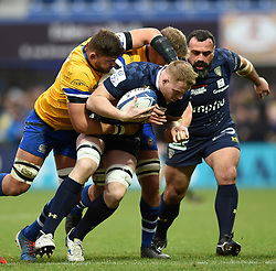 George Merrick of Clermont Auvergne is tackled by Mike Williams of Bath Rugby - Mandatory byline: Patrick Khachfe/JMP - 07966 386802 - 15/12/2019 - RUGBY UNION - Stade Marcel-Michelin - Clermont-Ferrand, France - Clermont Auvergne v Bath Rugby - Heineken Champions Cup