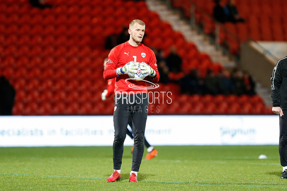 Adam Davies of Barnsley F.C. warms up for the EFL Sky Bet League 1 match between Doncaster Rovers and Barnsley at the Keepmoat Stadium, Doncaster, England on 15 March 2019.