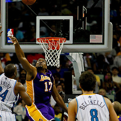 April 9, 2012; New Orleans, LA, USA; New Orleans Hornets power forward Carl Landry (24) shoots over Los Angeles Lakers center Andrew Bynum (17) during the second half of a game at the New Orleans Arena. The Lakers defeated the Hornets 93-91. Mandatory Credit: Derick E. Hingle-US PRESSWIRE