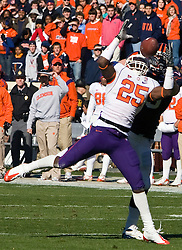 Clemson safety Michael Hamlin (25) intercepts a pass in action against UVA.  The Clemson Tigers defeated Virginia Cavaliers 13-3 in NCAA Division 1 football at Scott Stadium on the Grounds of the University of Virginia in Charlottesville, VA on November 22, 2008.