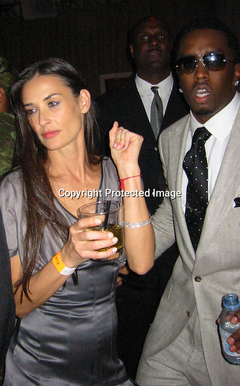 Demi Moore & Sean P. Diddy Combs.Sean P. Diddy Combs and Ron Burkle Present The Return of Gatsby .2003 MTV Movie Awards Post Party.Ron Burkle Beverly Hills Mansion.Los Angeles, Beverly Hills, CA.Saturday, May 31, 2003.Sales at Celebrityvibe.com/Photovibe.com