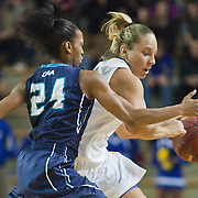 University of North Carolina Wilmington Junior Guard Jessica Freeman #24 playing tight defends on Delaware Junior Guard #10 Kayla Miller during a Colonial Athletic Association Conference Basketball Game against The Fightin Blue Hens