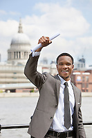 Excited African American businessman with St. Paul's Cathedral in the background