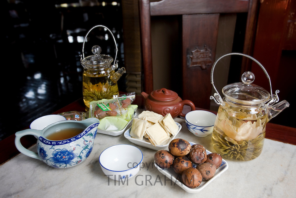 Flower infused teas and traditional snacks in the Huxinting Teahouse, Yu Garden Bazaar Market, Shanghai, China