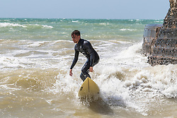 © Licensed to London News Pictures. 24/05/2020. Brighton, UK. Surfers take advantage of the windy weather to take to the sea in Brighton and hove on the May Bank Holiday Sunday. Photo credit: Hugo Michiels/LNP
