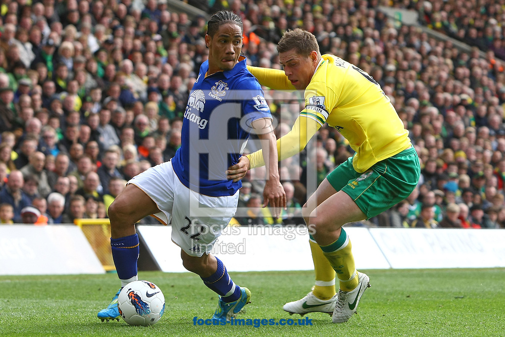 Picture by Paul Chesterton/Focus Images Ltd.  07904 640267.07/04/12.Grant Holt of Norwich and Steven Pienaar of Everton in action during the Barclays Premier League match at Carrow Road Stadium, Norwich.