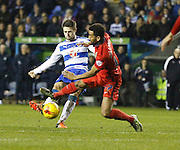 Blackburn Rovers midfielder, Lee Williamson gets a foot in but cant stop Reading midfielder, Oliver Norwood getting a shot away during the Sky Bet Championship match between Reading and Blackburn Rovers at the Madejski Stadium, Reading, England on 20 December 2015. Photo by Andy Walter.