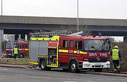 © Licensed to London News Pictures. 21/03/2013.Waste4fuel recycling centre fire continues to burn today (21.03.2013) after four days.. Firefighters are now in their 4th day of  tackling a fire affecting a large amount of waste at a recycling plant off Sevenoaks Way in Orpington,South East London..Three fire engines and 14 firefighters are at the scene in Cornwall Drive, Orpington, trying to damp down the several thousand tonnes of waste that are still smouldering..Six fire engines with 35 firefighters and officers were called to the fire at 5.47am on Monday morning (March 18)  from Eltham, Orpington, Sidcup, Bethnal Green, and Bromley fire stations.Photo credit : Grant Falvey/LNP