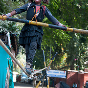 India. Bihar. Bodhgaya. A young girl performs on  a tightrope