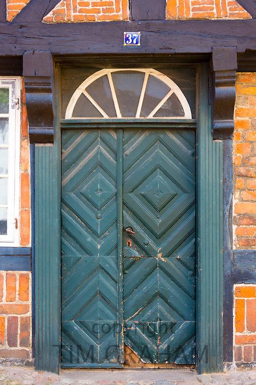 Painted door in medieval street in Ribe centre, South Jutland, Denmark