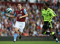 Photo: Rich Eaton.<br /> <br /> Aston Villa v Chelsea. The FA Barclays Premiership. 02/09/2007. Chelsea's Didier Drogba (r) and Villa's Gareth Barry (l) go for the ball.