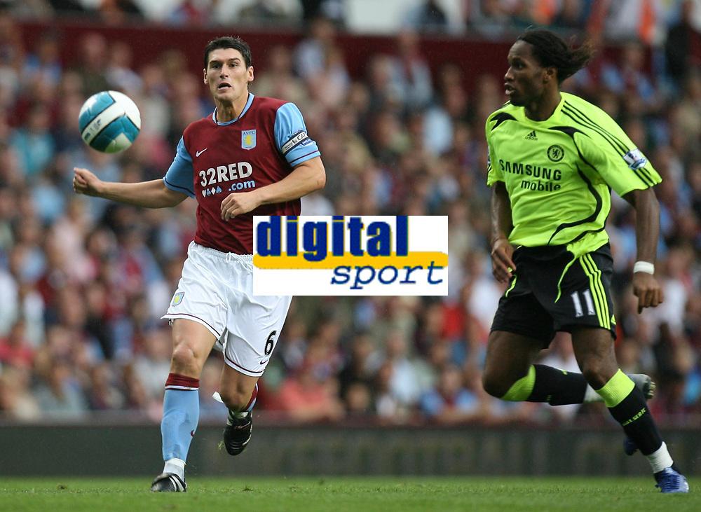Photo: Rich Eaton.<br /> <br /> Aston Villa v Chelsea. The FA Barclays Premiership. 02/09/2007. Chelsea's Didier Drogba (r) and Villa's Gareth Barry (l) go for the ball.
