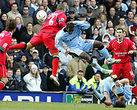 Photo: Paul Thomas. Coventry City v Cardiff City, Highfield Road, Coventry,  Coca Cola Chamionship. 12/03/2005. Daniel Gibbidon and Trevor Benjamin crash into each other going for the ball.
