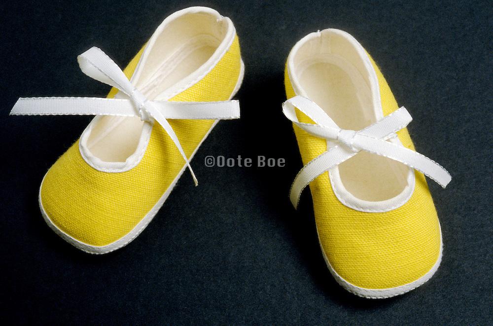 pair of yellow baby booties