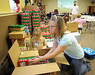 Jen Sedam and Ellie Sedam, 5 of Holland, Pennsylvania load shoebox packed gifts into boxes during Operation Christmas Child's National Collection Week Thursday November 19, 2015 in Langhorne, Pennsylvania.  (Photo by William Thomas Cain/Cain Images)