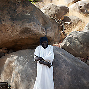 April 28, 2012 - Tabania, Nuba Mountains, South Kordofan, Sudan: A Nuba man recover from shrapnel injuries in a improvised field clinic near Tabania village in South Kordofan's Nuba Mountains in Sudan. ..Since the 6th of June 2011, the Sudan's Army Forces (SAF) initiated, under direct orders from President Bashir, an attack campaign against civil areas throughout the South Kordofan's province. Hundreds have been killed and many more injured...Local residents, of Nuba origin, have since lived in fear and the majority moved from their homes to caves in the nearby mountains. Others chose to find refuge in South Sudan, driven by the lack of food cause by the agriculture production halt due to the constant bombardments of rural areas. (Paulo Nunes dos Santos/Polaris)