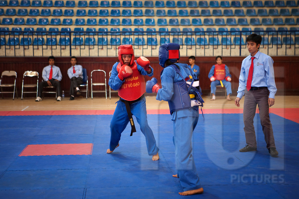 Vovinam - Viet Vo Dao Hanoi Championship, November 2010. Ha Dong stadium, Ha Tay, Hanoi, Vietnam. ©Sébastien LÖFFLER / NOI Pictures 2010. Vi?t Võ ??o is the philosophy behind Vovinam Vi?t Võ ??o. Vi?t to transcend or transcendence, derivative of the country name Vietnam. Võ martial art. ??o the way, the path one takes; the method or the principle. The term was coined by the patriarch of 2nd generation of the Vovinam Viet Vo Dao, the Grand Master Le Sang with the objective to add a philosophical dimension to his martial art. (wikipedia)
