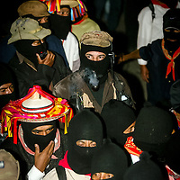 Masked rebel leader of the Zapatista National Liberation Army (EZLN) Subcomandante Marcos  waves as he arrives at a meeting in Palenque in the Mexican state of Chiapas January 3, 2006. Photographer/ Bernardo De Niz
