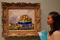 © under license to London News Pictures. 25/06/12. London, UK. A visitor admires the famous paining,Apples in Dish,1883, by Pierre-Auguste Renoir.The exhibition takes place at the Royal Academy of Arts. From Paris: A Taste of Impressionism - paintings from the Clark exhibition. The exhibition showcases seventy major works, many of which have never been on public display in the U.K before...ALEX CHRISTOFIDES/LNP