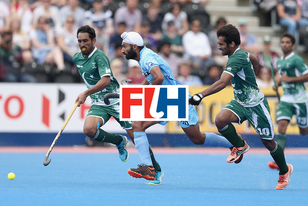 LONDON, ENGLAND - JUNE 24: Talwinder Singh of India is closed down by Ali Shan of Pakistan and Tasawar Abbas of Pakistan  during the 5th-8th place match between Pakistan and India on day eight of the Hero Hockey World League Semi-Final at Lee Valley Hockey and Tennis Centre on June 24, 2017 in London, England. (Photo by Alex Morton/Getty Images)