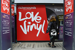 © Licensed to London News Pictures. 13/04/2019. LONDON, UK. Vinyl music promotion. Analogue music fans visit independent record shops in Soho to celebrate vinyl music on the 12th Record Store Day.  Over 200 independent record shops across the UK come together annually to celebrate the unique culture of analogue music with special vinyl releases made exclusively for the day.  In 2018, sales of vinyl rose for the 11th consecutive year to 4.2 million units according to the British Phonographic Industry (BPI).  Photo credit: Stephen Chung/LNP