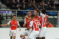 Arsenal's Lukas Podolski celebrates with his team mates after scoring. - Photo mandatory by-line: Dougie Allward/JMP - Mobile: 07966 386802 - 22/10/2014 - SPORT - Football - Anderlecht - Constant Vanden Stockstadion - R.S.C. Anderlecht v Arsenal - UEFA Champions League - Group D
