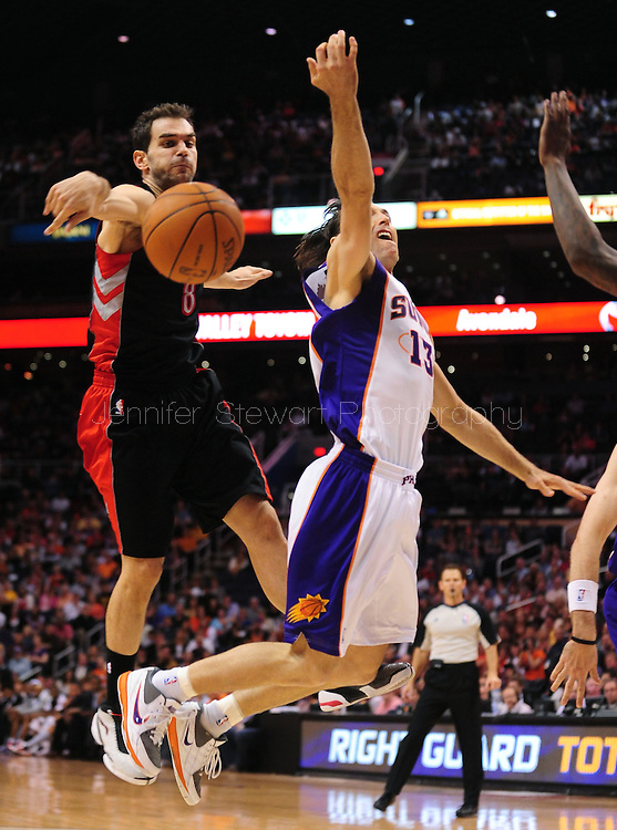 Mar. 23, 2011; Phoenix, AZ, USA; Phoenix Suns guard Steve Nash (15) is blocked by the Toronto Raptors guard Jose Calderon (8) the US Airways Center. The Suns defeated the Raptors 114-106. Mandatory Credit: Jennifer Stewart-US PRESSWIRE