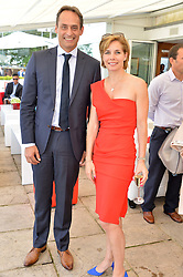 ANDRE KONSBRUCK Director of Audi UK and DARCEY BUSSELL at the Audi International Polo at Guards Polo Club, Windsor Great Park, Egham, Surrey on 26th July 2014.