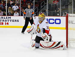 Jan 4, 2008; Newark, NJ, USA; Ottawa Senators goalie Alex Auld (31) makes a glove save during the second period at the Prudential Center.