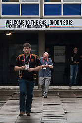 © licensed to London News Pictures. London, UK 14/07/2012. G4S's new recruitments walking outside the company's Recruitment & Training Centre in Stratford this morning. Photo credit: Tolga Akmen/LNP